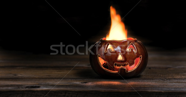 Halloween pumpkin on fire during the night time  Stock photo © tab62
