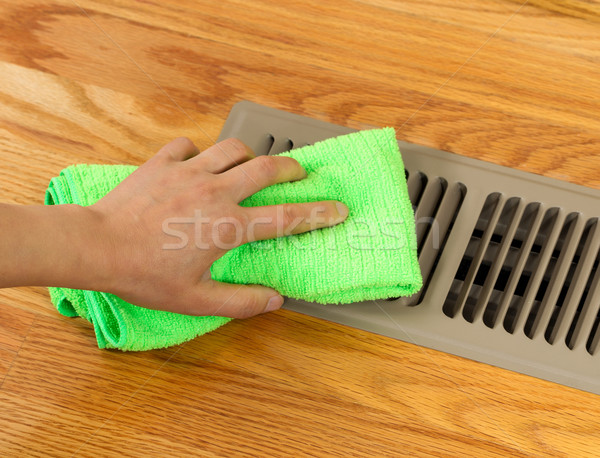 Hand Cleaning Grill Plate of Floor Heating Vent in Home  Stock photo © tab62