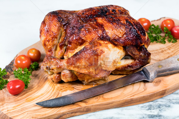 Large whole chicken ready to be carved on wooden server board  Stock photo © tab62