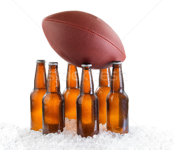 Six pack of ice cold bottled beer with American football isolate Stock photo © tab62