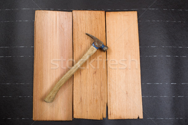 Used roofing hammer with new cedar wood shingles on felt paper   Stock photo © tab62