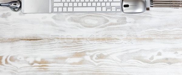 Top border of modern technology devices on white wooden boards Stock photo © tab62