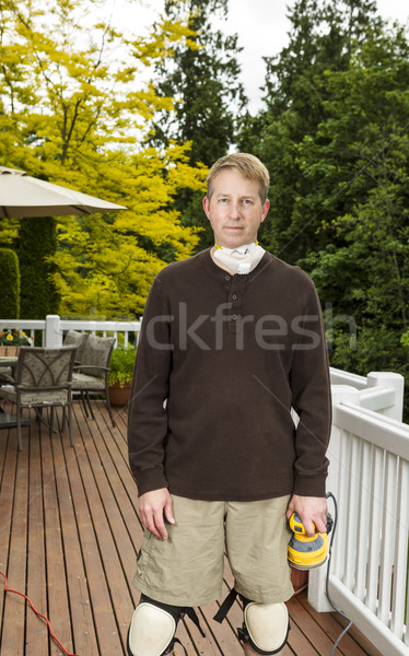 Mature man getting ready to work on outdoor deck Stock photo © tab62
