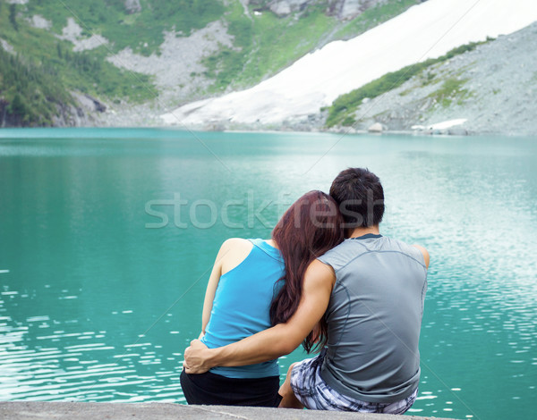Young Adults Lovers Looking at Pristine Aqua Mountain Lake  Stock photo © tab62