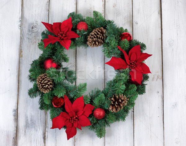 Holiday Poinsettia Christmas wreath on rustic white wooden board Stock photo © tab62