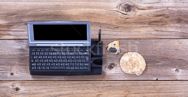 Vintage computer and stone fossils on rustic wooden boards  Stock photo © tab62