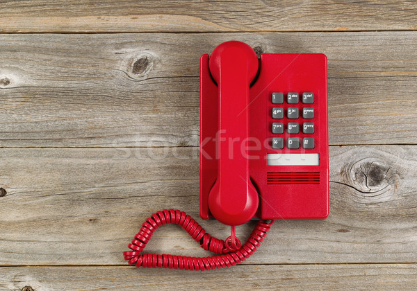 Vintage red phone on rustic wooden boards Stock photo © tab62