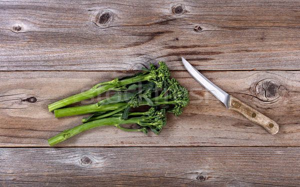 Fresh Chinese broccoli and paring knife on rustic wood  Stock photo © tab62