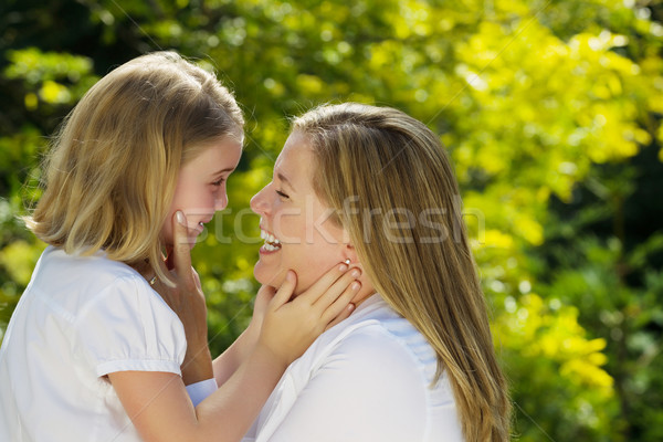 Mother and daughter sharing a moment together outdoors  Stock photo © tab62
