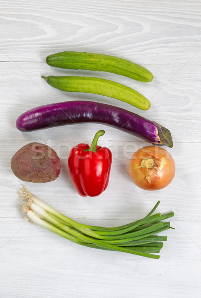 Freshly picked vegetables on white wood background Stock photo © tab62