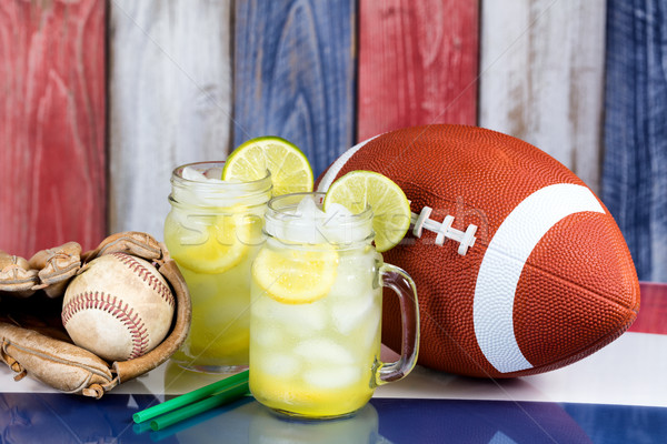 Glass jars filled with cold lemonade along with sporting objects Stock photo © tab62