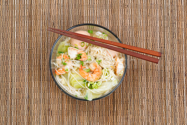 Hot spicy Chinese noodle soup in glass bowl Stock photo © tab62