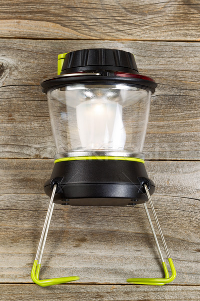 New outdoor battery lantern on rustic wooden boards  Stock photo © tab62