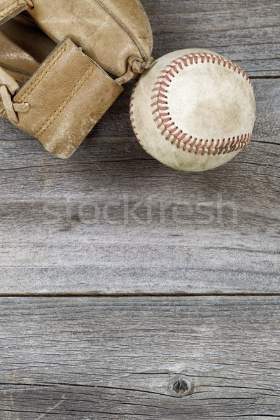 Used baseball and weathered mitt on old wood Stock photo © tab62
