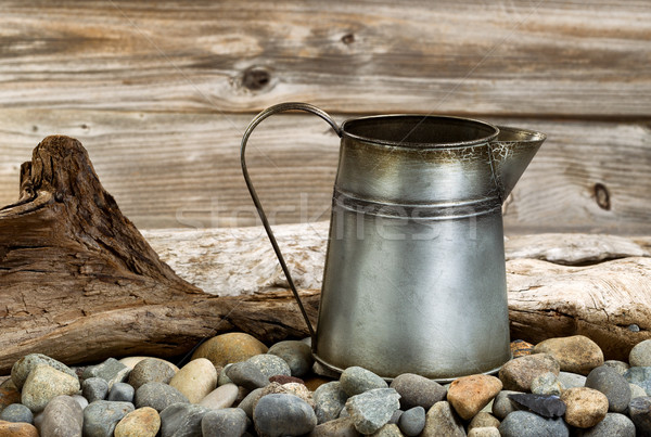 Vintage coffee pot on stone fire pit with driftwood in backgroun Stock photo © tab62