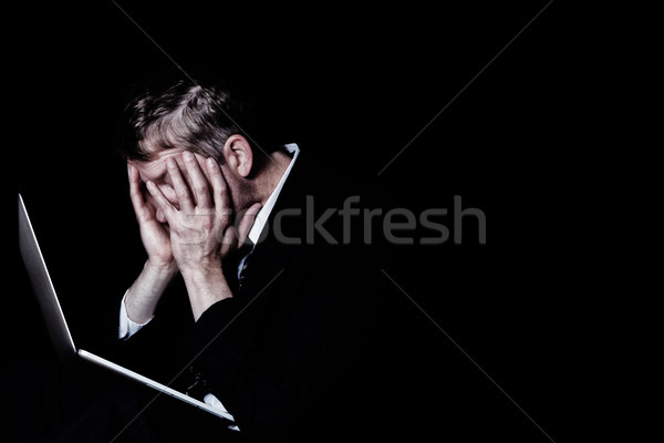 Heavily stressed man at work in the darkness Stock photo © tab62