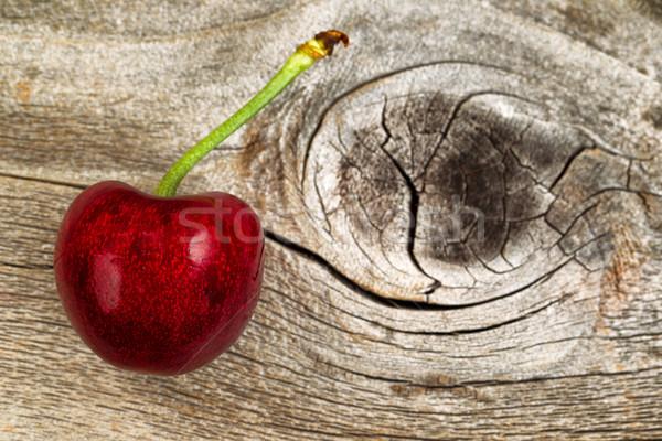 Ripe single black cherry aged wood Stock photo © tab62