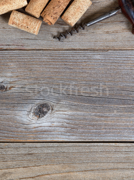 Top border of vintage corkscrew and used corks on rustic wooden  Stock photo © tab62
