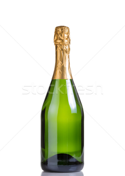 Unopened bottle of champagne isolated on white background  Stock photo © tab62