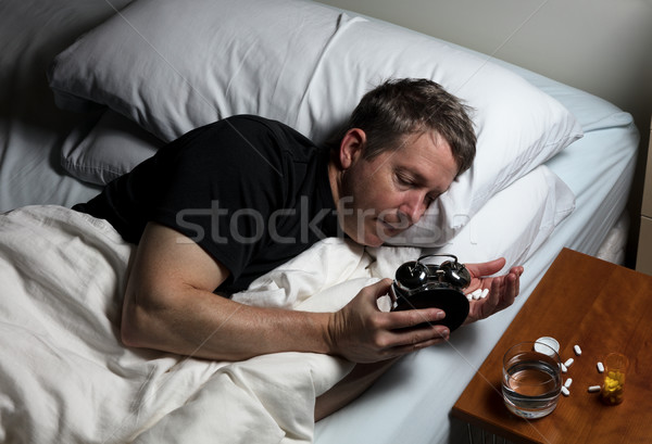 Mature man having difficulty falling asleep at night thus taking Stock photo © tab62