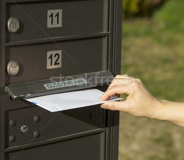 Sending letter to outgoing postal mailbox  Stock photo © tab62