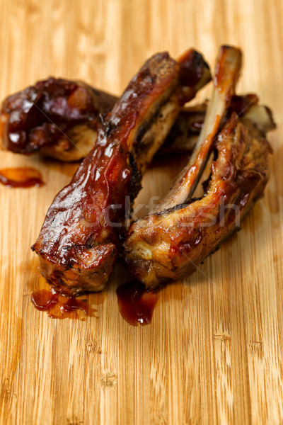 Freshly cooked BBQ ribs with sauce on wooden board  Stock photo © tab62
