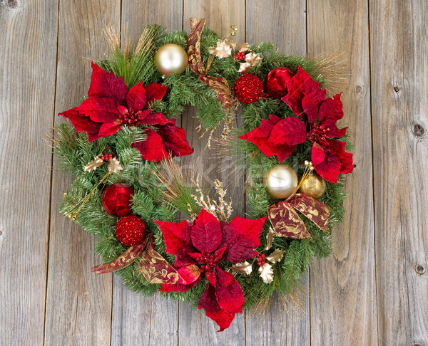 Traditional holiday Christmas wreath on rustic wooden cedar boar Stock photo © tab62
