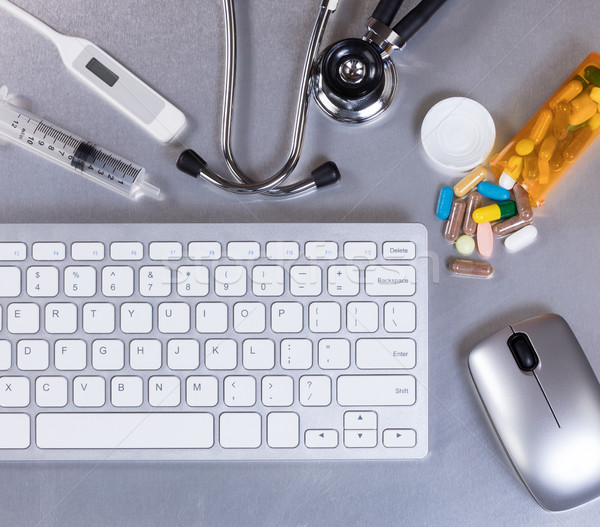 Stainless steel desktop with medical doctor equipment and comput Stock photo © tab62