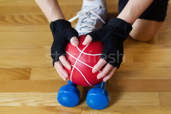 Weights being picked up off of Gym Wooden Floor  Stock photo © tab62