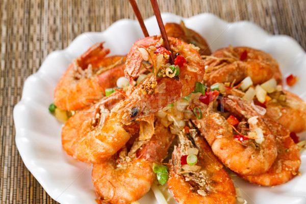 Fried bread coated shrimp and garnishes on white serving plate r Stock photo © tab62