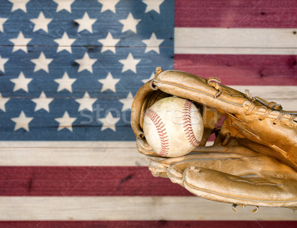 Weathered baseball mitt and ball with faded boards painted in Am Stock photo © tab62