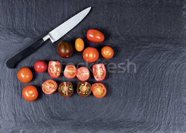 Colorful mixed small tomatoes and cutting knife on natural black Stock photo © tab62