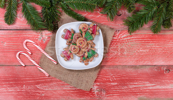 Rustic red wooden boards with Christmas cookies and candy canes  Stock photo © tab62