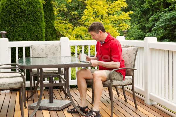 Mature Man reading outside on patio  Stock photo © tab62