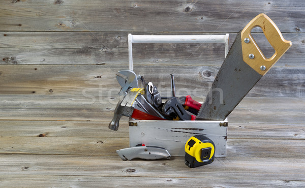 Stock photo: Tool Holder filled with handyman tools on aged wood