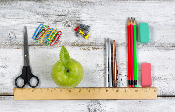 School supplies in line with ruler on white desktop  Stock photo © tab62