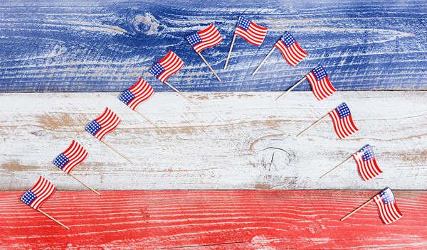 Small USA flags in arch formation on rustic boards with national Stock photo © tab62