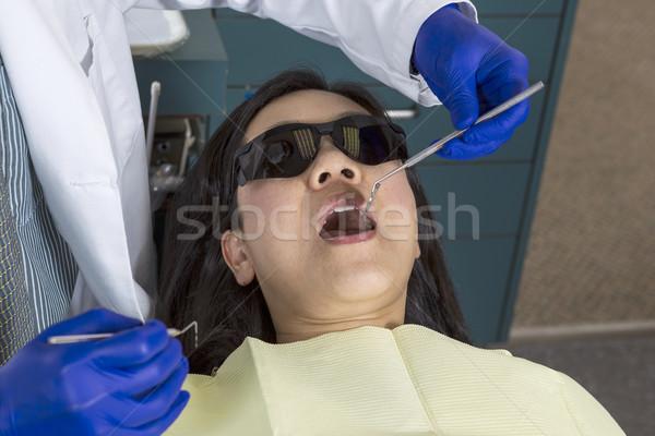 Dentist working on mature woman  Stock photo © tab62