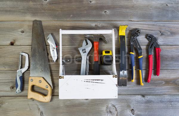 Basic tools with Holder on weathered wood  Stock photo © tab62