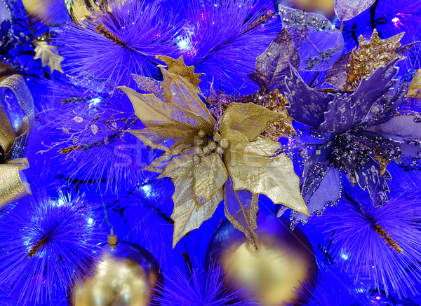 Golden poinsettia with ornaments hanging from white Christmas tr Stock photo © tab62
