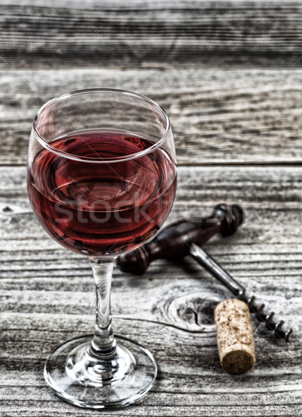 Vintage corkscrew with red wine in glass Stock photo © tab62