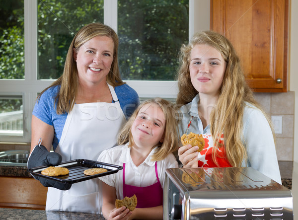 Family of Girls of eating freshly baked cookies  Stock photo © tab62