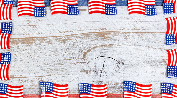 Border of small USA flags on rustic boards with national colors  Stock photo © tab62