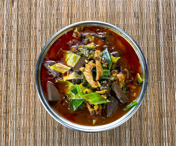 Freshly cooked spicy vegetable soup in pot on bamboo mat backgro Stock photo © tab62