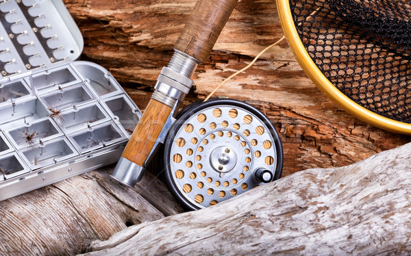 Vintage fly fishing outfit and gear on rocks and wood background Stock photo © tab62