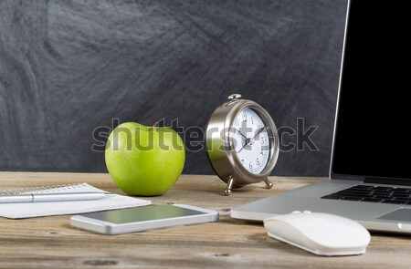 Green apple on an old wooden classroom desktop with technology  Stock photo © tab62