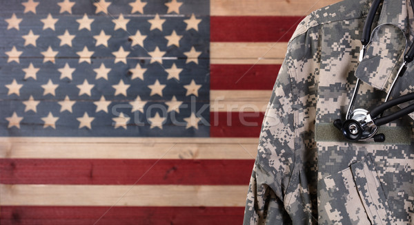 Close up of military uniform jacket and stethoscope with rustic  Stock photo © tab62