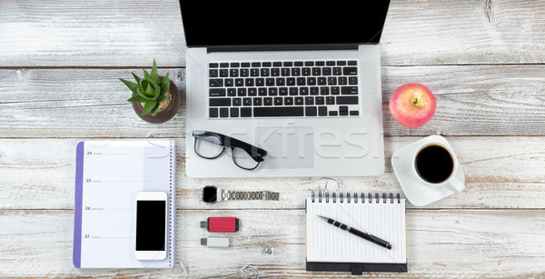 Top view of a wireless technologies on white rustic wooden deskt Stock photo © tab62