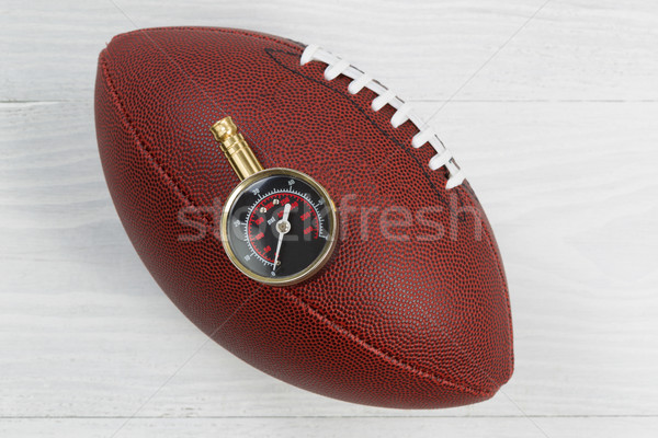 American football being tested for proper inflation of ball  Stock photo © tab62