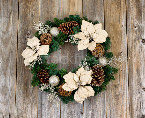 Holiday white Poinsettia Christmas wreath on rustic cedar wooden Stock photo © tab62